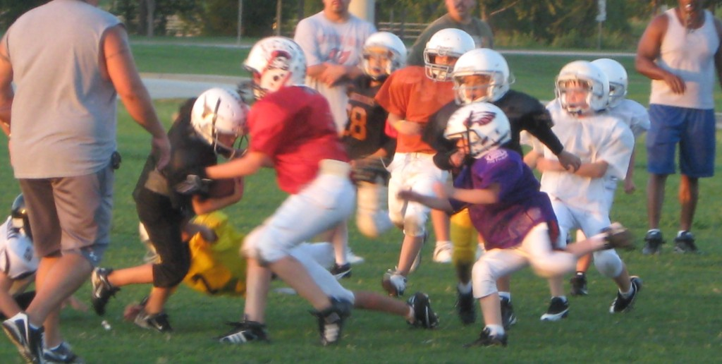 Berndt and Zane playing youth football
